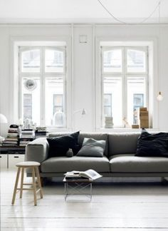 the dark grey sofa