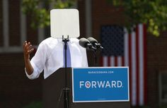 A teleprompter obscures U.S. President Obama as he speaks during a campaign event in Columbus, Ohio