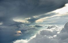 Clouds photographed 4 miles up through open airplane doors | Colossal #clouds #photography #cloud #sky