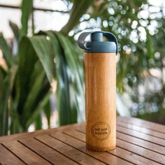 Bamboo Bottle End the use of plastic bottles with this Sustainable Bamboo Water Bottle. Durable, reusable and eco-friendly, each bottle features a unique color and finish and comes with a silicone lid. They are carefully handmade by makers and families from local villages throughout Vietnam. The sustainably-sourced bamboo is food safe, and heat resistant.