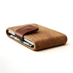 These exquisite Haydanhuya wood wallets are handmade using a single piece of premium wood. They feature a pull-out leather strip or a sturdy elastic band that secures up to ten cards.