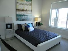 Bedroom with large painting