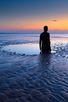 Photographs of Antony Gormley's 'Another Place' by Paul Sutton | Imaginary Foundation #sun #water #photography #colors #silhouette #rise #beach