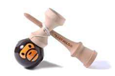 kendama — a traditional Japanese toy made of wood that resembles a cup-and-ball game. bape baby milo