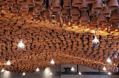Sweeping Clay Canopy From Upside-Down Pots