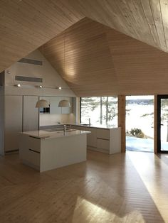 This Modern Finnish House Consists of Three Barns Put Together in a Y Shape 10