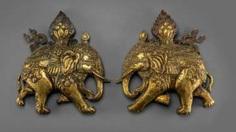 Pair of fine fire-gilded repoussé technology-models of caparisoned elephants