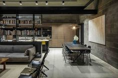 Raw Concrete and Black-Painted Metal Give Industrial Feeling to Jacobs-Yaniv House 12