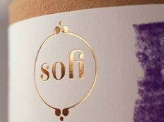 Sofi Bath Bombs | Lovely Package #typography #packaging #white #purple #gold #close #up #tins