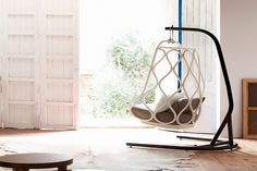 Nautica Hanging Chair by Expormim - IPPINKA The Nautica Hanging Chair is an entirely unique specimen. It pays homage to one of the very first pieces incepted by Expormim in the seventies. Additionally, just like its predecessor, it uses rattan in bold new refreshing ways.