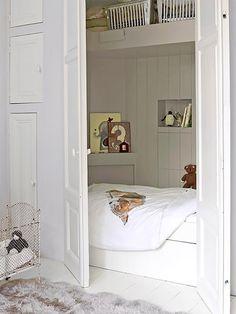Closet sleeping nook in a kid's room