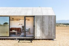 Portable House ÁPH80 is a minimalist house located in Spain, designed by Ábaton Arquitectura. The outside is covered with grey cement wood #house #small