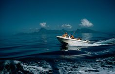 A motorboat carries tourists to fishing grounds off Tahiti, July 1962.Photograph by Luis Marden, National Geographic #photography #vintage #boat #film