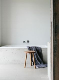 Bathroom. Photo by Tara Pearce. #bathroom #concrete #bathtub