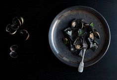 Squid ink pasta with clams and white wine