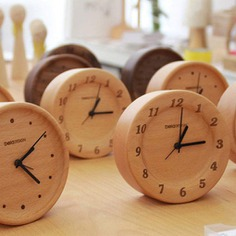 Beech Wood Table Clock These Beech Wood Table Clocks are stylish and modern alarm clocks great for office and bedroom use. They are made out of 100% German beech wood and have a subtle fragrance. The clocks are hand carved with natural wood wax oil and have no coverings on the dial plate.