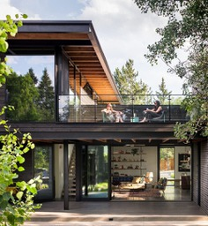 second level, a glass-lined terrace overlooks the backyard