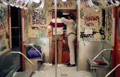 A Couple Looks Through a Window to the Next Subway Car - 20 Vintage New York Graffiti Photos   Complex