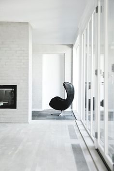 Living area with fireplace. Bang House by Norm.Architects. #normarchitects #livingroom #fireplace #egg