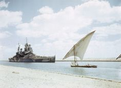 HMS Howe passes through the Suez Canal on her way to join the British Pacific Fleet.