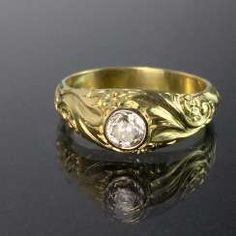 Exclusive brilliant solitaire ring: 0.6 - 0.65 carat, White/yellow gold 585/14 K, high-quality goldsmith and engraver work.