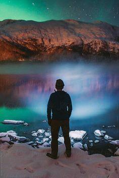 Man Looking At Lake Under Northern Lights