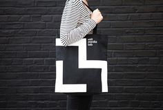 Varia — Design & photography related inspiration #bag #white #branding #black #wear #logo