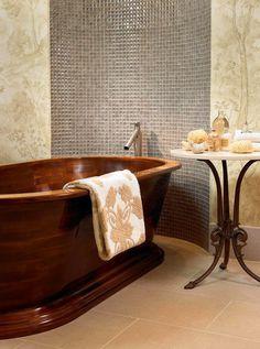 Artistic tiles in modern bathroom with bathtub