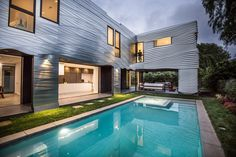 The Wave House, a Modern home with outdoor, small patio, porch, deck, grass, large pool, back yard, and stone patio, porch, deck.