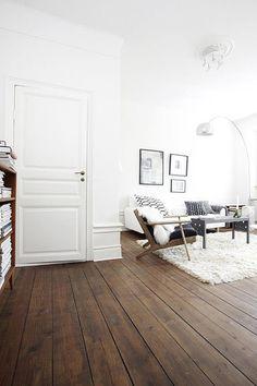 White living room with wooden floor. #livingroom #minimalist