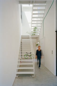 White metal staircase. Apartment building by AN+. © Florian Holzherr. #staircase