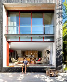 Modern House in Vancouver with a Green Wall at Backyard - InteriorZine