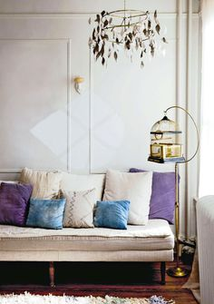 inside out magazine sofa - bird cage and chandelier