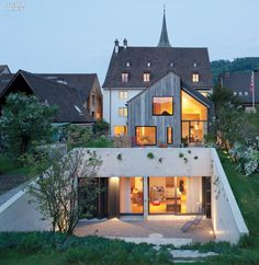 Oppenheim Architecture & Design Adapts Historic Swiss Farmhouse For Muttenz Office