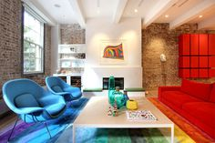 New York Duplex Apartment by Ghislaine Vinas Interior Design - rainbow colored living room decor