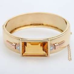 Bangle, bes. with a citrine in a step cut
