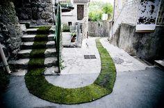 grass carpet winds through a french village #art #france #grass carpet