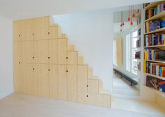 Apartment in Paris by Schemaa features a staircase made of cupboards #interior