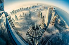 a blaze with light dubai in fog sebastian opitz 1 #dubai #clouds #in #city #the #photography