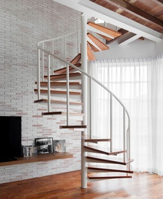 Compact Mezzanine Apartment with Spiral Staircase - InteriorZine