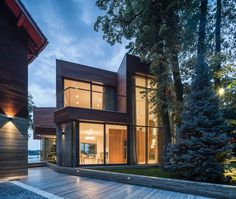 Extensive Use of Glass Defining Modern Lake House in Romania: Villa Snagov
