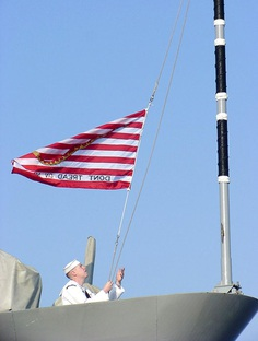 "Raising of the ""Navy Jack"" for the first time at morning colors, on September 11, 2002, aboard the guided missile cruiser Thomas S. Gates in honor of those killed in the September 11, 2001 attacks."