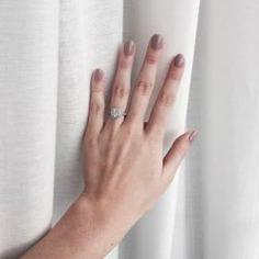 Cushion-cut diamond engagement ring on point