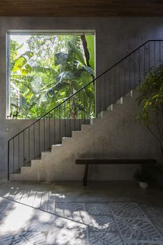 Concrete stairs and large window. Thong House by NISHIZAWAARCHITECTS. © Decon Photo Studio. #concrete #stairs #window