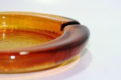 Manly vintage amber glass ashtray heavy by WaterBetweenStones #glass #ashtray #amber