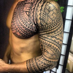 Chest and sleeve Polynesian Tattoo with spearheads and braids