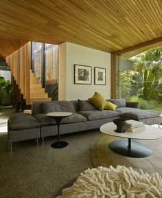 Cottage With a Series of Indoor and Outdoor Spaces