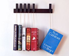 Hanging Book Shelving is a simple and unique way to display your book collection. #productdesign #industrialdesign #modern #furnituredesign