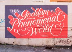 Goddam Phenomenal World on Typography Served #phenomenal #red #purple #mural #art #typography #type #painted #script #cursive #beautiful #wo