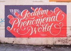 Goddam Phenomenal World on Typography Served #phenomenal #red #purple #mural #art #typography #type #painted #script #cursive #beautiful #wo